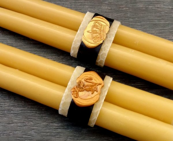 Beeswax wrapping around taper candles with wax seal and ribbon