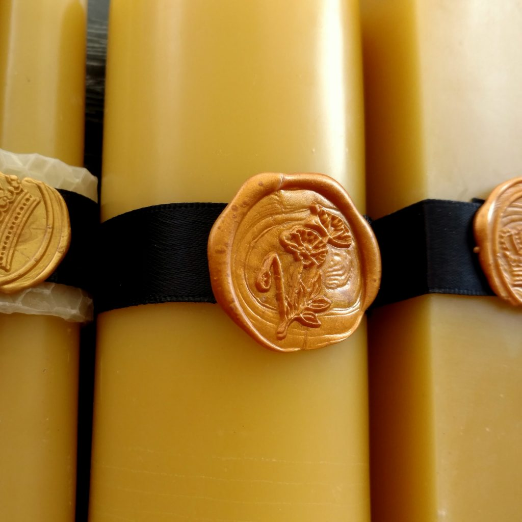 Close up of pillar candles with wax seal